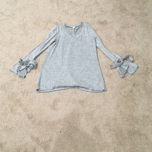 Super soft split bell sleeve w/exaggerated bow v